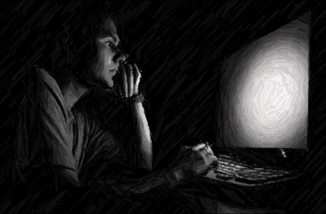 man-working-on-computer-in-the-dark